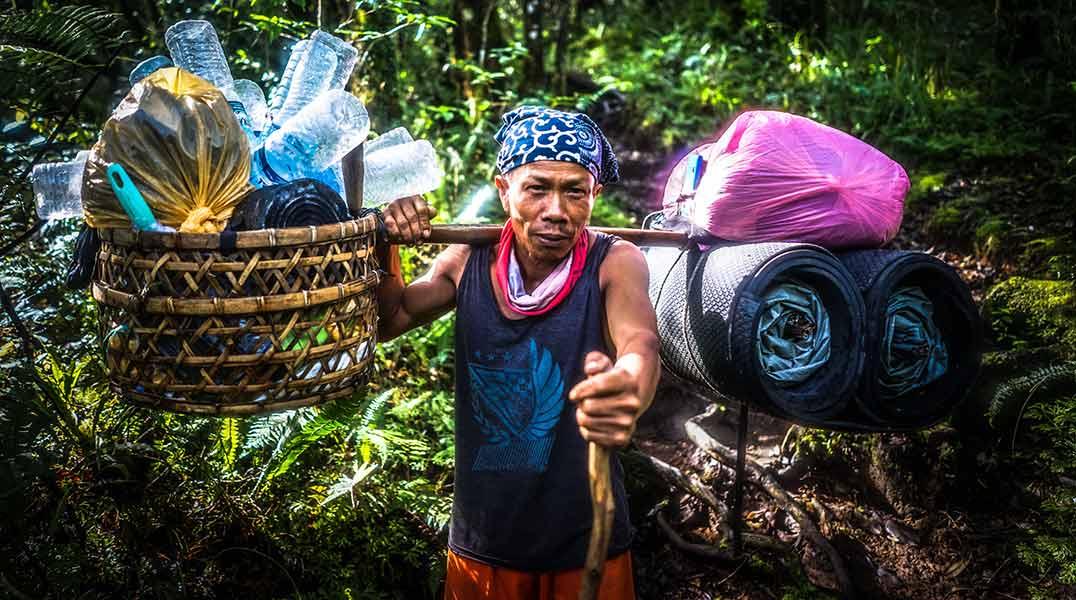 What is Eco Tourism - Man Collecting Plastic Bottles - Safari Buddies Blog