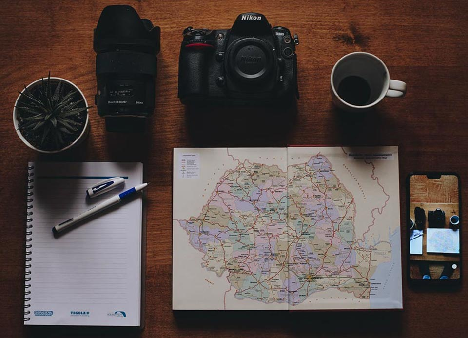 Wildlife Planning - camera, Map and coffee mug on a table