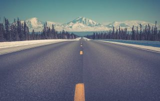 Alaska Road leading to mountains- The best time to visit Alaska - Safari Buddies Blog