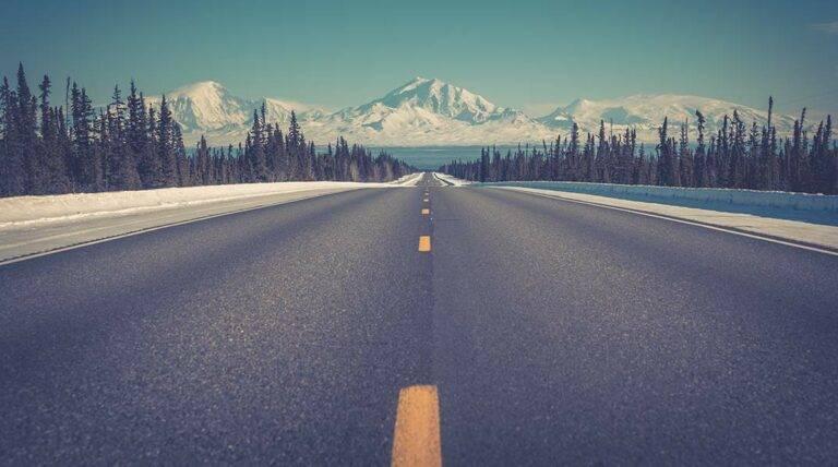 Alaska Road leading to mountains- The best time to visit Alaska - Safari Buddies Blog